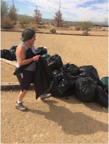CSN Latin American Studies and Spanish Instructor Dr. Valerie Hecht, who is also co-director of the Latin American Studies Program, helps clean up Sunrise Trailhead as part of a Hispanic Heritage Month service day event.