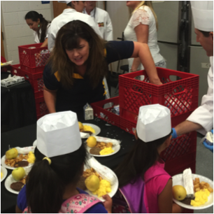 CSN Senior Vice President of Strategic Initiatives and Administrative Services helps serve breakfast at Lois Craig Elementary School, an at-risk school with Chef for Kids.